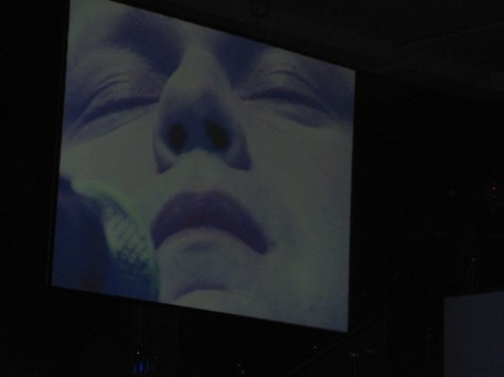 "The huge screen with a close up of Paul Potts singing his final aria, ""Nessun Dorma"""