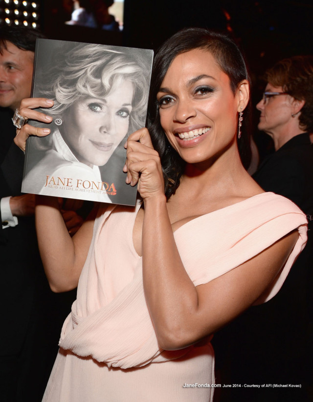 Rosario Dawson holding the program