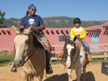 James and his daughter Skye on the horses